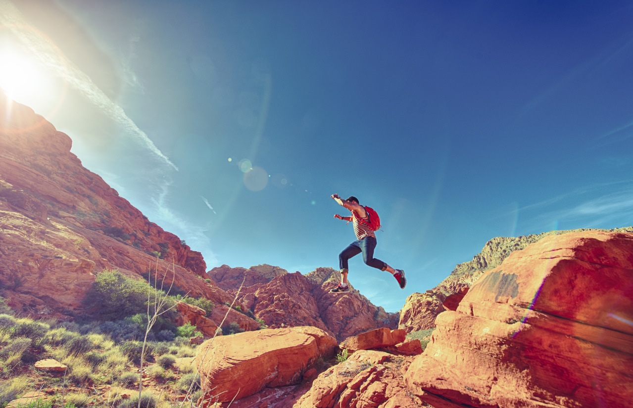 Athletic_Man_Jumping_Between_Rocks_In_Outdoor_National_Park